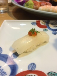 A piece of squid sushi from Hatsuhana