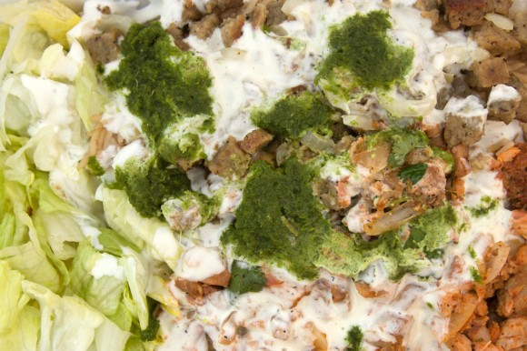 Chicken and lamb over rice with white and green sauce from Sammy's Halal Food