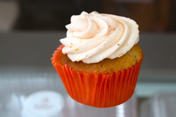 A peach cupcake from Baked Cravings