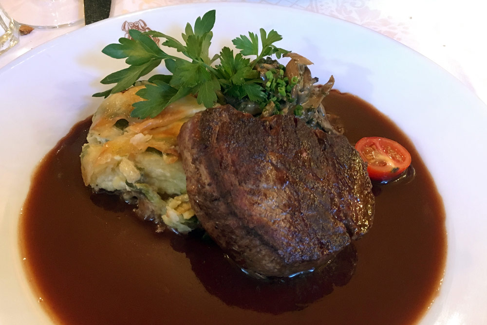Steak, potatoes, and mushrooms with Bordelaise from À La Petite Chaise